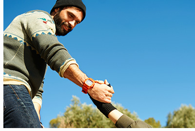 Helping hand - hiking girl get help from a smiling man focus at hands on hike happy overcoming obstacle. Active lifestyle hiker couple traveling. Beautiful mixed race Asian Caucasian female model.
