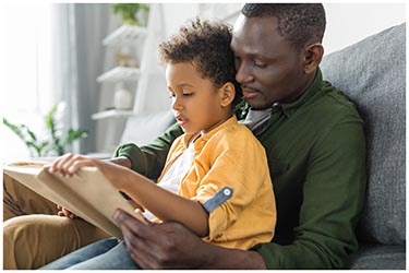 father reading to son, second chance