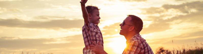Father and Son enjoy the Sunset