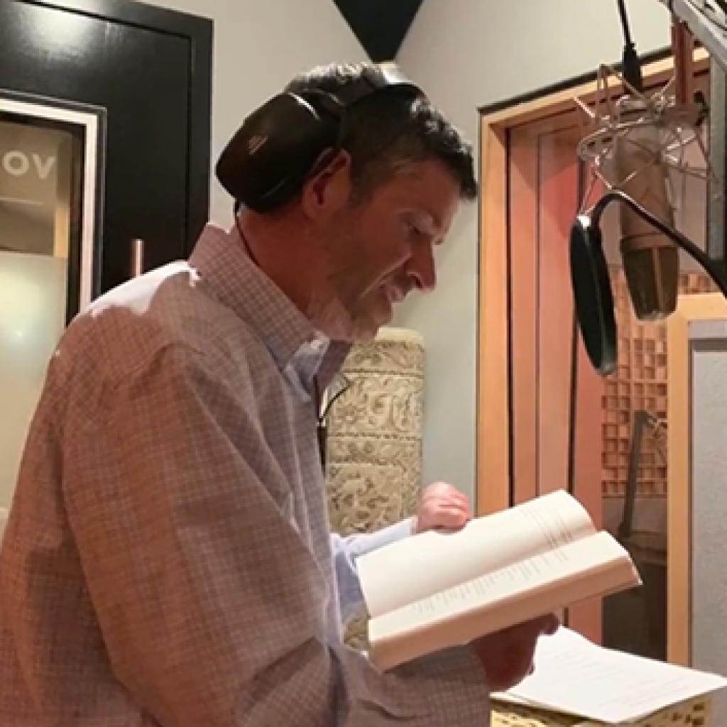 John records audio book.