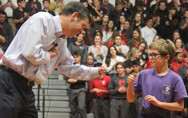 Curtis John fist bumping with hope